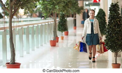 Girl walking the hallway in the mal - Shopping
