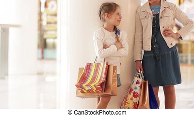 Two sisters with shopping and looki