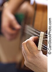 Spanish guitar - Closeup of a Spanish guitar during a...
