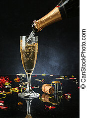Pouring a champagne flute for celebration time (with...