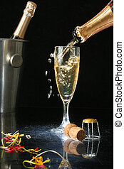 Pouring a champagne flute for celebration time. (with...