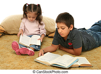 Brother and sister reading books on the floor - Brother and...