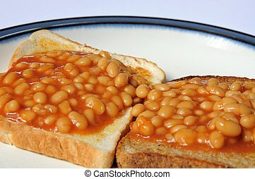 Baked beans on toast. - Two rounds of baked beans on toast,...