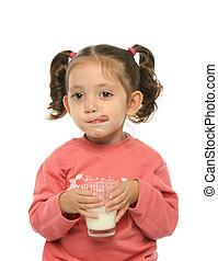 Cute little girl drinking milk - Toddler enjoying a glass of...