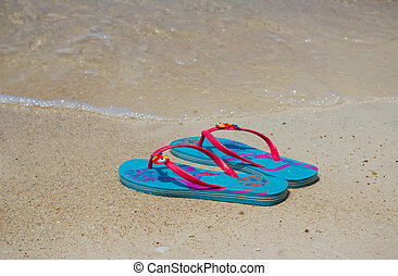 Colored flip-flops on the beach