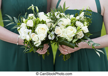 bridesmaids hold flowers - bridesmaids in green dresses...