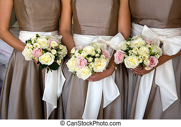 bridesmaids with flowers - bridesmaids holding bouquet of...