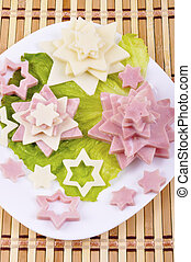 appetizer with ham and cheese, decorated with star and leaf...