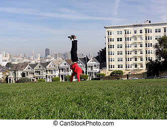 Handstanding in front of the painted ladies buildings of San Francisco, California