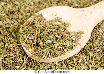 herb thyme and wooden spoon as background