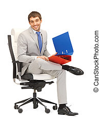 man with folders - bright picture of handsome man with...