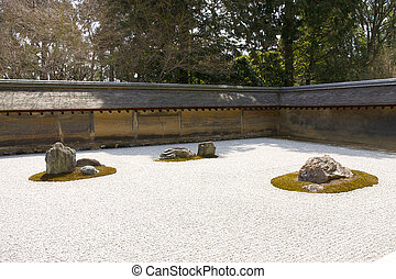 Rock garden in Ryoan-ji temple, Kyoto, Japan. - Rock garden...