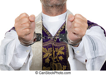 catholic priest in handcuffs. abuse - a catholic priest in...