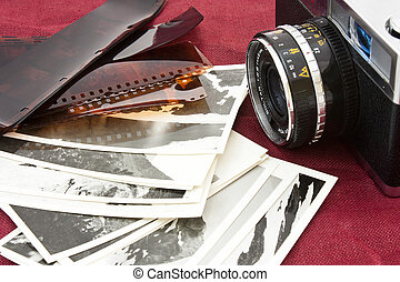 memories - several stack of antique photos and old camera