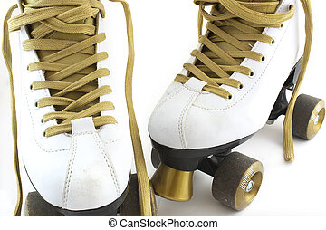 gold and white rollerskates - a pair of white and gold...