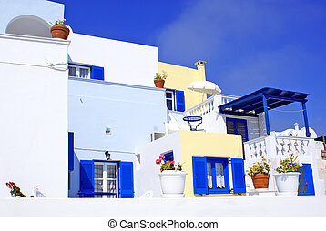 Old Greek  traditional house with blue window in Santorini island, Greece