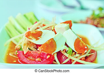 Som-Tum - Close up of Thai style papaya salad with salted...