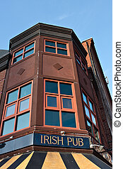 Irish Pub Sign - Old building with a sign on front that...
