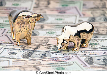 dollar currency notes with bull and bear - many dollar bills...