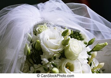 Bridal veil and flowers - Bridal bouquet cowered with white...