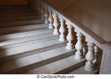 ancient marmoreal stairs with balusters in daylight