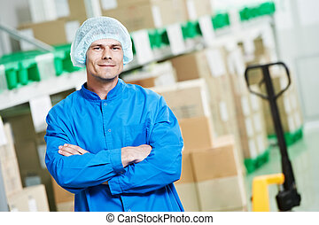 medical warehouse worker - young handsome medical warehouse...