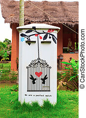Postbox - White and Traditional thai postbox on garden.