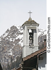 small bell tower in winter, Formazza, Italy