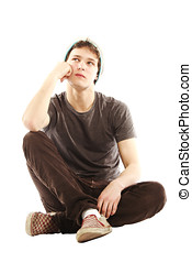 Young man dressed in hip style contemplative - Young man...