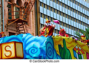 Mardi Gras Parade - Mardi Gras parade throwing beads to...