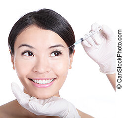 Cosmetic injection in woman face