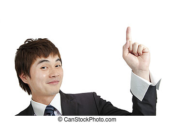 smiling asian businessman pointing and Isolated on white