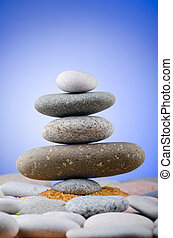 Balanced pebbles with colour background