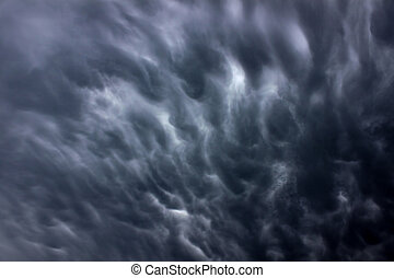 Dark Thunderstorm Clouds - Ominous clouds precede the strong...