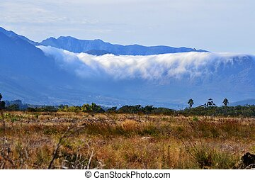Mountains in clouds - landscape of moutains with clouds