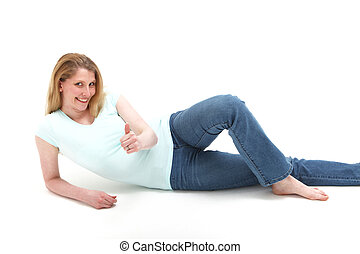 Pretty smiling blonde girl reclining on the floor