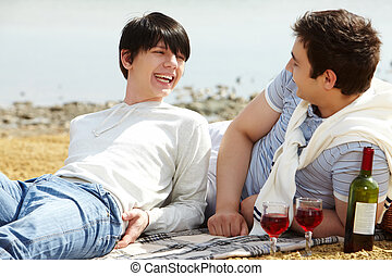 Wine and lovers - Laughing gay couple having a good time...