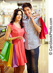 Romantic shopping - Romantic couple with shopping bags...