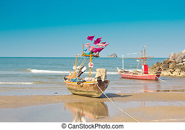 The fishing boats are on the beach