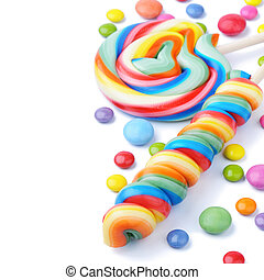Colorful lollipops and smarties isolated on white