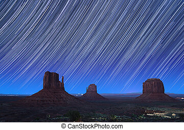 Monument Valley Star Trails 1 - Monument Valley at dusk with...