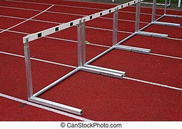 Hurdles Athletic Stadion - 1 - Hurdles and red running...