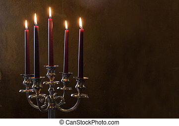 Five red candles lighted on painted room - Five red candles...