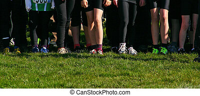 Legs of Running Kids - Legs of kids ready at the start of a...