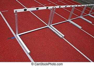 Hurdles Athletic Stadion - 2 - Hurdles and red running...