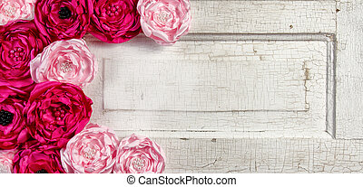 Pink vintage flowers on aged door - Pink vintage flowers on...