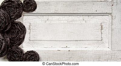 Black flowers on vintage doore
