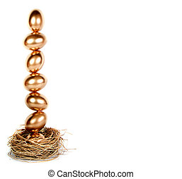 Golden eggs balanced in a nest (nest egg) - Golden eggs...