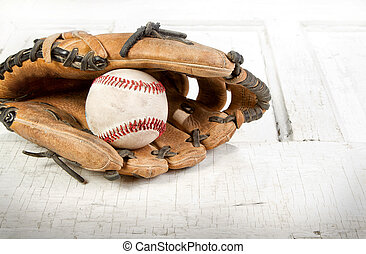 Baseball and mitt on a white grunge background