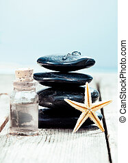 Spa massage stones with essential oil